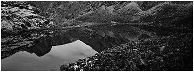 Mountain lake with reflections in rocky environment. Gates of the Arctic National Park (Panoramic black and white)