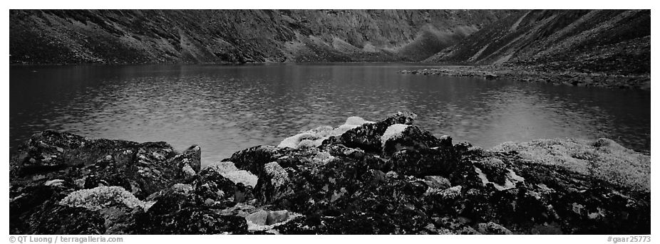 Dark rocks, lichen, and mountain lake. Gates of the Arctic National Park (black and white)