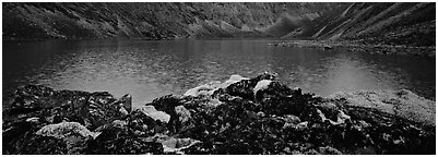 Dark rocks, lichen, and mountain lake. Gates of the Arctic National Park (Panoramic black and white)