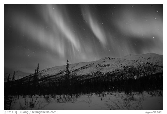 Colorful aurora curtains over Brooks Range. Gates of the Arctic National Park (black and white)