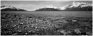 Snowy mountains rising above water. Glacier Bay National Park (Panoramic black and white)