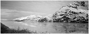 Snowy mountains rising above fjord. Glacier Bay National Park (Panoramic black and white)