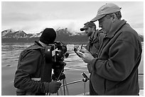 Team begins filming a movie sequence. Glacier Bay National Park, Alaska, USA. (black and white)
