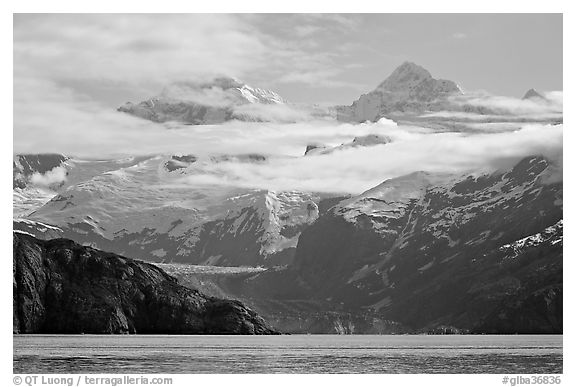 Rugged peaks of Fairweather range rising abruptly above the Bay. Glacier Bay National Park (black and white)