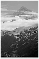 Pointed mountain with clouds hanging below. Glacier Bay National Park, Alaska, USA. (black and white)
