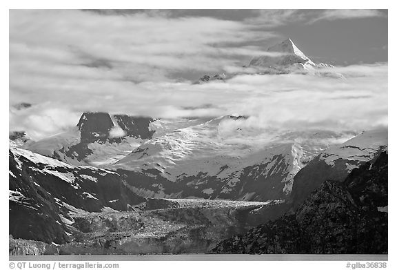 Pointed peaks of Fairweather range emerging from clouds. Glacier Bay National Park (black and white)