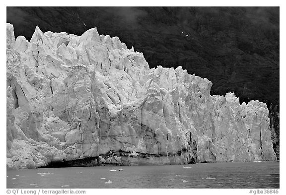 Front of Margerie Glacier against dark mountainside. Glacier Bay National Park (black and white)
