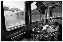 Breakfast potatoes in a small boat moored in front of glacier. Glacier Bay National Park ( black and white)