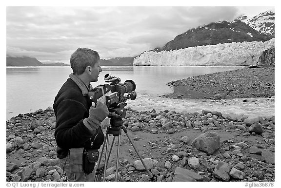 Cameraman filming in Tarr Inlet. Glacier Bay National Park (black and white)