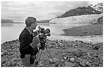 Cameraman filming in Tarr Inlet. Glacier Bay National Park, Alaska, USA. (black and white)