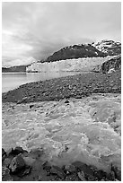 Stream flowing into Tarr Inlet, with Margerie Glacier in background. Glacier Bay National Park ( black and white)