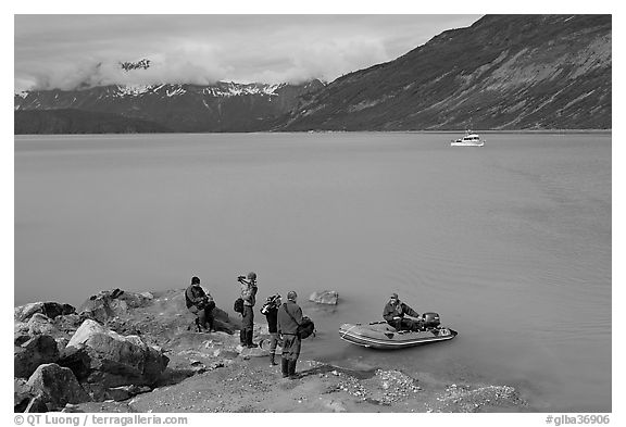 Film crew met by a skiff after shore excursion. Glacier Bay National Park (black and white)