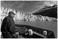 Captain guiding boat near Lamplugh glacier. Glacier Bay National Park ( black and white)