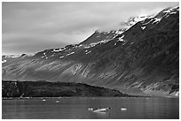 Slopes at the base of Mount Barnard illuminated by a late ray of sun. Glacier Bay National Park ( black and white)