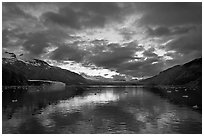 Mount Forde, Margerie Glacier, Mount Eliza, Grand Pacific Glacier, and Tarr Inlet, cloudy sunset. Glacier Bay National Park, Alaska, USA. (black and white)