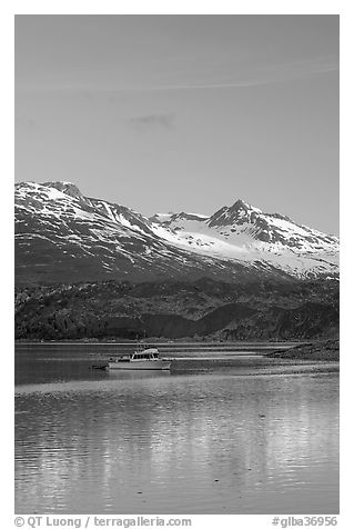 Small boat at the head of Tarr Inlet, early morning. Glacier Bay National Park (black and white)