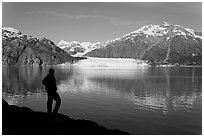 Man in silhouette looking at Tarr Inlet, Fairweather range and Margerie Glacier. Glacier Bay National Park ( black and white)