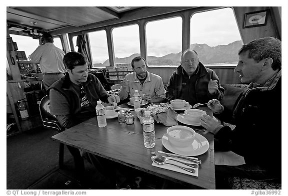 Passengers eating a soup for lunch. Glacier Bay National Park (black and white)