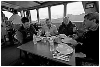 Passengers eating a soup for lunch. Glacier Bay National Park, Alaska, USA. (black and white)