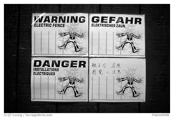 Sign in Brooks campground, warning of the electric fence used to keep the bears out. Katmai National Park (black and white)