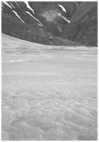 Ash formation on the floor of the Valley of Ten Thousand smokes, below the green hills. Katmai National Park, Alaska, USA. (black and white)
