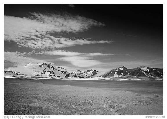 Snow-covered peaks surrounding the arid ash-covered floor of the Valley of Ten Thousand smokes. Katmai National Park (black and white)