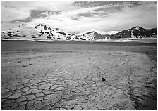 The desert-like floor of the Valley of Ten Thousand smokes is surrounded by snow-covered peaks such as Mt Meigeck. Katmai National Park, Alaska, USA. (black and white)