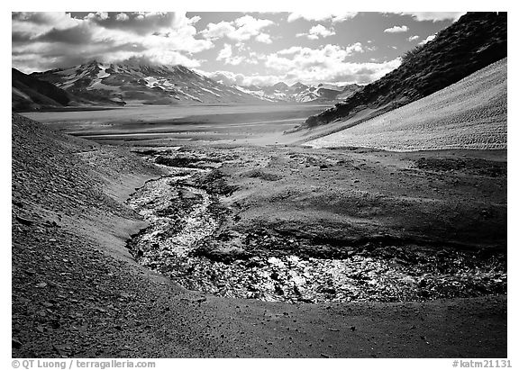 Stream flows from the hills into the floor of the Valley of Ten Thousand smokes. Katmai National Park (black and white)