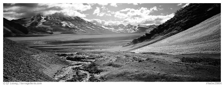Stream flowing into arid ash-covered valley. Katmai National Park (black and white)