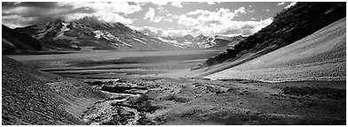 Stream flowing into arid ash-covered valley. Katmai National Park (Panoramic black and white)