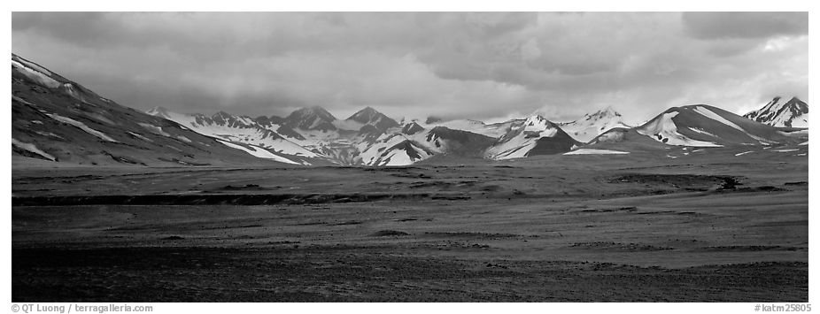 Desert-like ash-covered valley surrounded by snowy peaks. Katmai National Park (black and white)