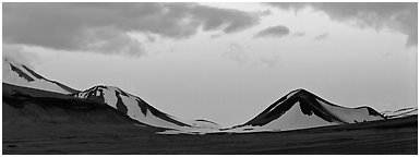 Snow-covered mountains with pink dusk sky. Katmai National Park (Panoramic black and white)