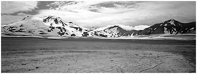 Snow-covered mountains surrounding ash-covered flats. Katmai National Park (Panoramic black and white)