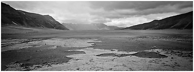 Arid ash plain landscape with colorful deposits. Katmai National Park (Panoramic black and white)