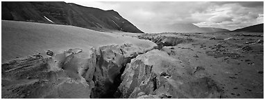 Volcanic landscape with deep gorge cut into ash valley. Katmai National Park (Panoramic black and white)