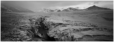 Stormy landscape with ash-covered valley and mountains. Katmai National Park (Panoramic black and white)