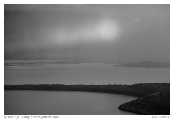 Rainbow in sun shaft piercing clouds. Katmai National Park (black and white)