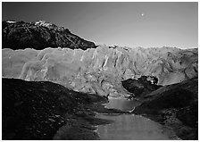 Front of Exit Glacier, sunrise and moon. Kenai Fjords National Park, Alaska, USA. (black and white)
