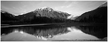 Mountains and glacier reflected in Resurrection River. Kenai Fjords National Park (Panoramic black and white)