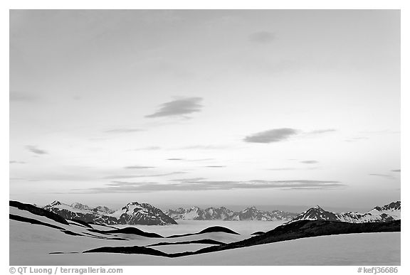 Pastel sky, mountain ranges and sea of clouds at dusk. Kenai Fjords National Park (black and white)