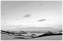 Pastel sky, mountain ranges and sea of clouds at dusk. Kenai Fjords National Park, Alaska, USA. (black and white)