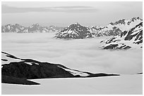 Mountains above low fog at dusk. Kenai Fjords National Park, Alaska, USA. (black and white)