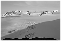Snow-covered glacier and Harding Ice field peaks, sunrise. Kenai Fjords National Park ( black and white)