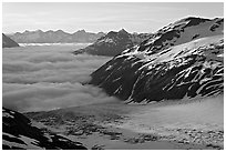 Craggy peaks, glacier, and sea of clouds. Kenai Fjords National Park, Alaska, USA. (black and white)