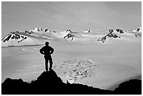 Man standing on overlook above Harding ice field, early morning. Kenai Fjords National Park ( black and white)