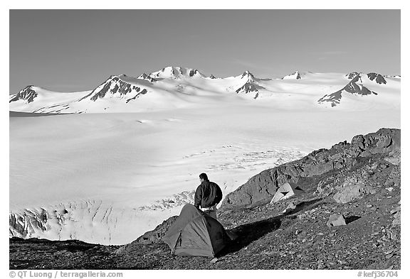 Tent and backpacker above the Harding icefield. Kenai Fjords National Park (black and white)