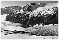 Peaks, glacier, and sea of clouds, morning. Kenai Fjords National Park, Alaska, USA. (black and white)