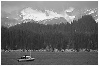 Small boat in Aialik Bay. Kenai Fjords National Park, Alaska, USA. (black and white)