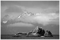 Rocky islets and cloud-shrouded peaks, Aialik Bay. Kenai Fjords National Park, Alaska, USA. (black and white)