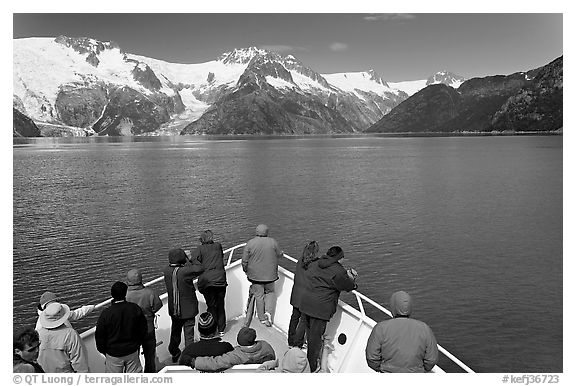 Vistors on bow of tour boat approaching glacier, Northwestern Fjord. Kenai Fjords National Park (black and white)